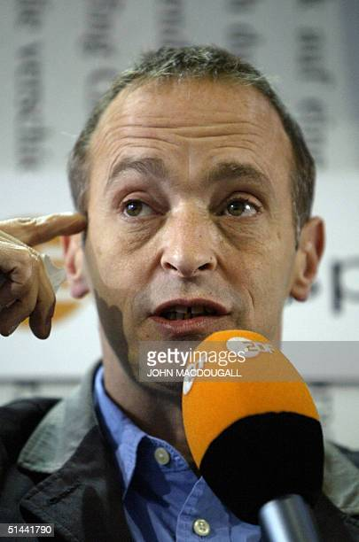 US writer residing in France David Sedaris gestures during an interview with German TV ZDF during the Frankfurt Book Fair 08 October 2004 AFP PHOTO...