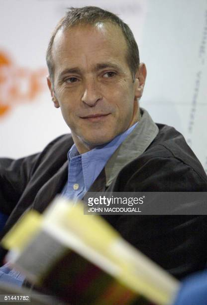 Writer residing in France David Sedaris is interviewed by German TV channel ZDF during the Frankfurt Book Fair 08 October 2004. AFP PHOTO JOHN...