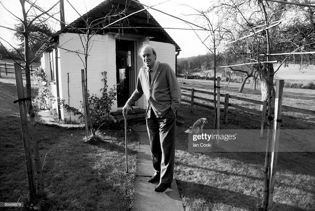 Writer Roald Dahl holds onto his cane while standing outside the shed where he writes; Great Missenden, Buckinghamshire, England.