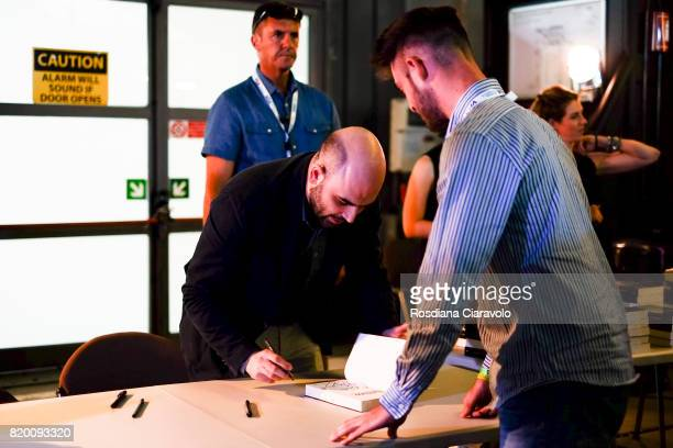 Writer Roberto Saviano during signing copies of his novel at Campus Party on July 20, 2017 in Milan, Italy.