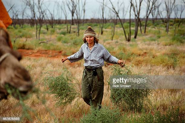 Writer Robyn Davidson is photographed for National Geographic in 1977 in the outback Australia The day after Dookie's fall Robyn spent hours...