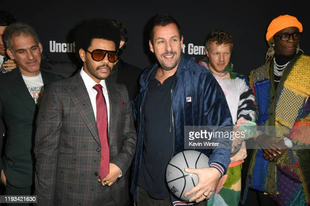 Writer Ronald Bronstein The Weeknd Adam Sandler Sebastian Bear McClard and Young Thug attend the premiere of A24's Uncut Gems at The Dome at Arclight...