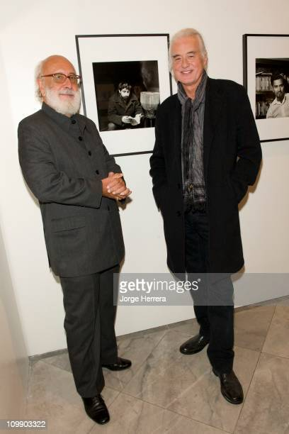 Writer Royston Ellis and musician Jimmy Page pose next to Royston Eliss' portait by Ida Kar during the private view of 'Ida Kar Bohemian Photographer...