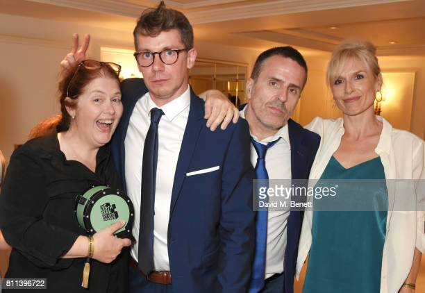 Writer Sally Wainwright Karl Davies Con O'Neill and Amelia Bullmore winners of the TV Drama award for 'Happy Valley' pose in the winners room at The...