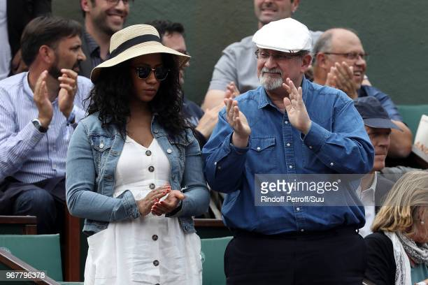 Writer Salman Rushdie and a guest attend the 2018 French Open Day Ten at Roland Garros on June 5 2018 in Paris France