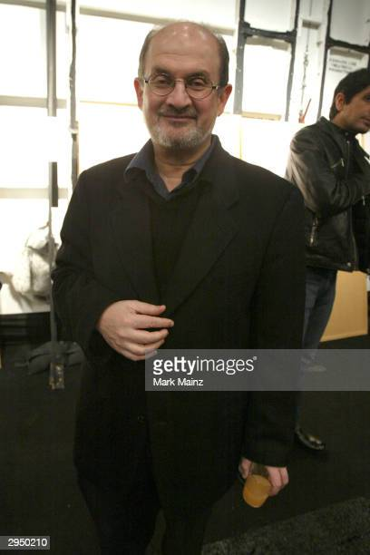 Writer Salman Rushdie appears backstage at the Luca Luca Fall 2004 fashion show during the Olympus Fashion Week Fall 2004 at Bryant Park February 8,...