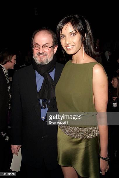 Writer Salman Rushdie with girlfriend Padma Lakshmi at the Luca Luca Fall 2002 fashion show at Bryant Park during the MercedesBenz Fashion Week...