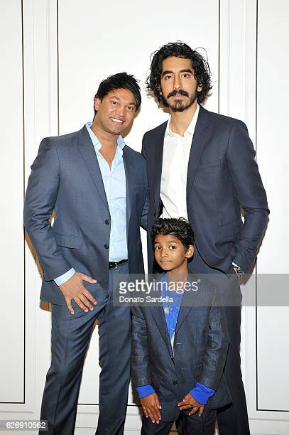 Writer Saroo Brierley and actors Dev Patel and Sunny Pawar wearing Burberry at Burberry and The Weinstein Company honour Dev Patel and his...