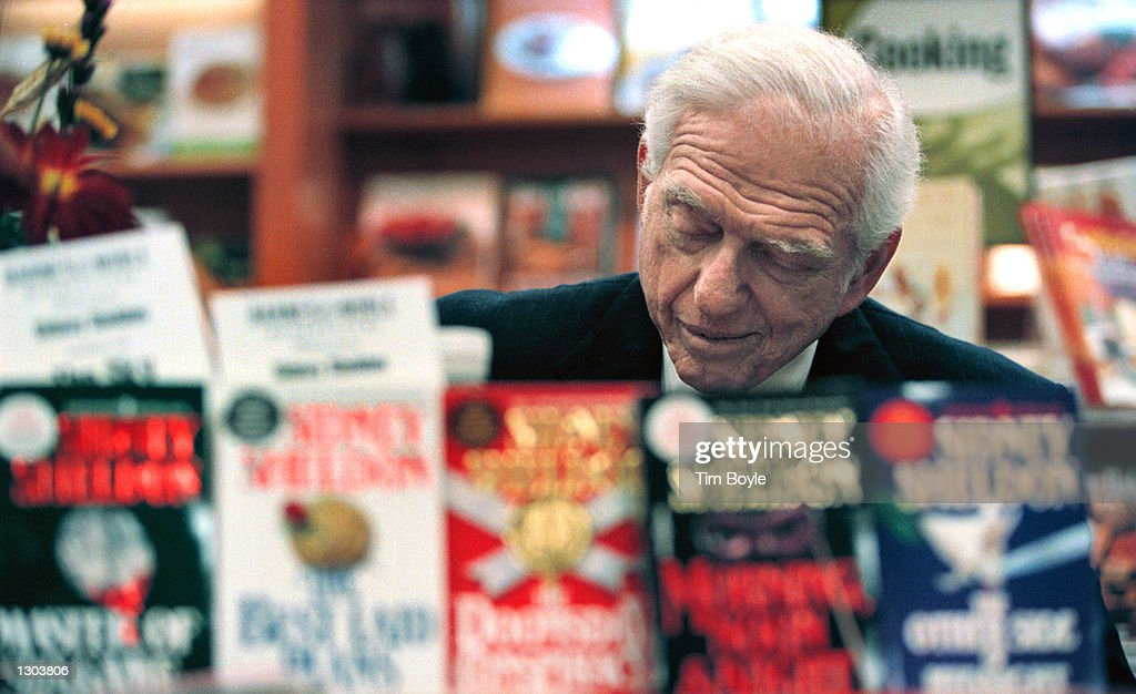 Writer Sidney Sheldon at Book Signing : News Photo