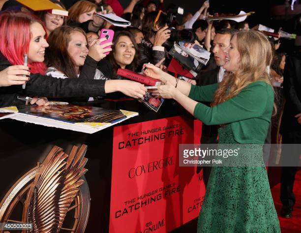 Writer Suzanne Collins attends premiere of Lionsgate's The Hunger Games Catching Fire Red Carpet at Nokia Theatre LA Live on November 18 2013 in Los...