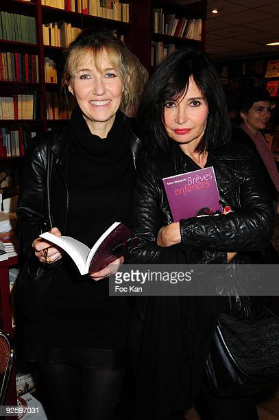 Writer Sylvie Bourgeois Harel and comedian Evelyne Bouix attend the 'Breves Enfances' Sylvie Bourgeois Harel's Book Launch Cocktail at the Ecume des...