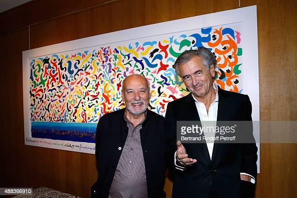 Writer Tahar Ben Jelloun and BernardHenri Levy attend the 'Paintings Poems from Tahar Ben Jelloun Furniture Scriptures from CSaccomanno ODayot' Press...