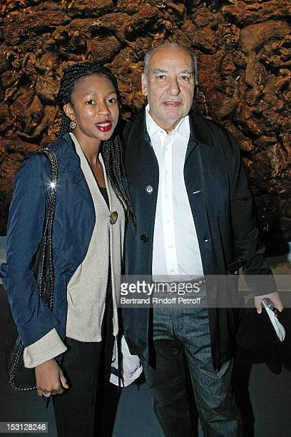 Writer Tahar ben Jelloun and Jemina pose in front Who's afraid of the big bad wolf of Adel Abdessemed during Adel Abdessemed exhibition premier at...