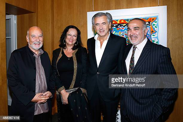 Writer Tahar Ben Jelloun BernardHenri Levy Galerist of Gallery Tindouf in Marrakech and Tanger Boubker Temli and his wife attends the 'Paintings...