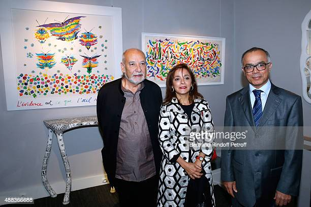 Writer Tahar Ben Jelloun Morocco's ambassador in France Chakib Benmoussa and his wife attend the 'Paintings Poems from Tahar Ben Jelloun Furniture...