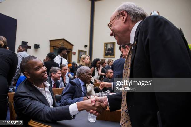Writer Ta-Nehisi Coates shakes hands with House Subcommittee Chairman Steve Cohen during a hearing on slavery reparations held by the House Judiciary...