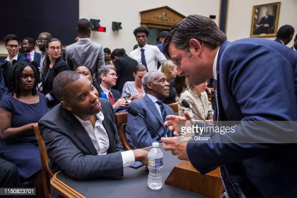 Writer TaNehisi Coates shakes hands with House Subcommittee Ranking Member Mike Johnson following a House Judiciary Subcommittee hearing on slavery...