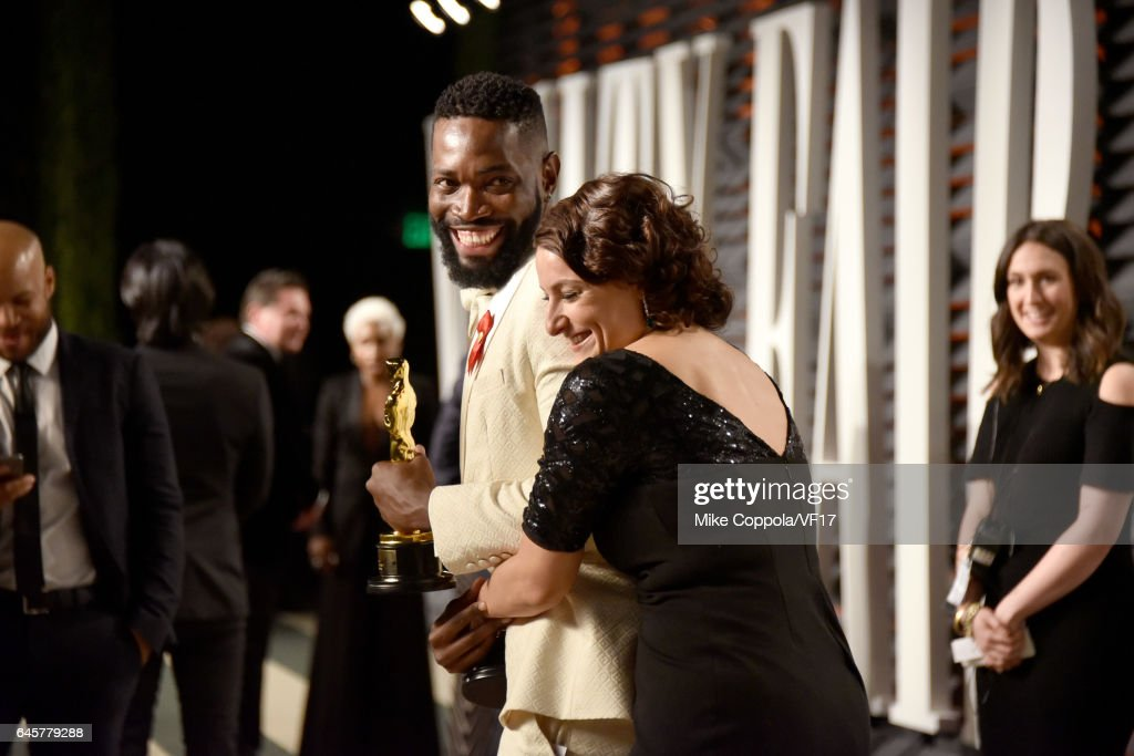 Writer Tarell Alvin McCraney (L) and producer Adele Romanski attend the 2017 Vanity Fair Oscar Party hosted by Graydon Carter at Wallis Annenberg Center for the Performing Arts on February 26, 2017 in Beverly Hills, California.