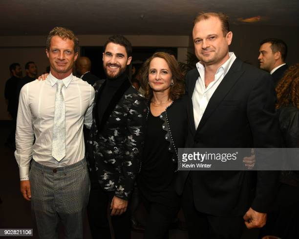 Writer Tom Rob Smith actor Darren Criss executive producers Nina Jacobson and Brad Simpson pose at the after party for the premiere of FX's 'The...