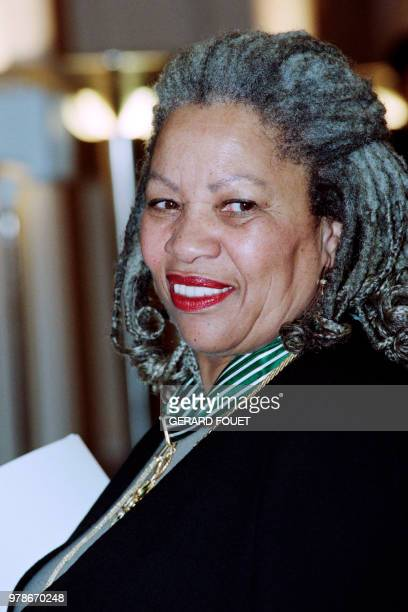 US writer Toni Morrison poses on December 16 1993 in Paris after being awarded with the insignia of 'Commandeur des Arts et des Lettres' by French...
