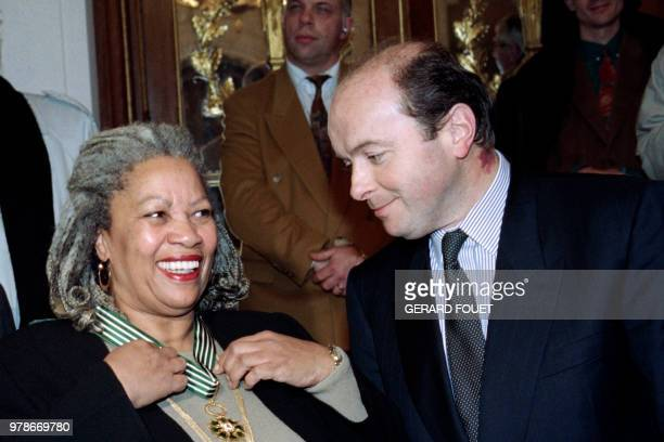 US writer Toni Morrison smiles on December 16 1993 in Paris after being awarded with the insignia of 'Commandeur des Arts et des Lettres' by French...