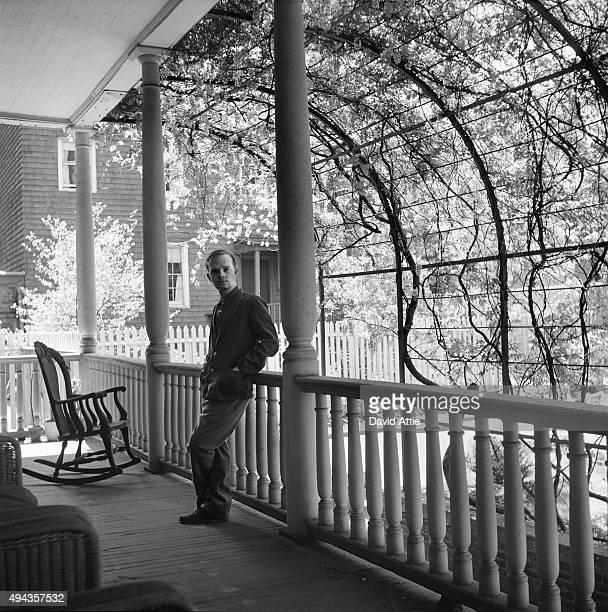 Writer Truman Capote poses for a portrait in the house he lived in at 70 Willow Street where he wrote 'Breakfast at Tiffany's' and 'In Cold Blood' in...