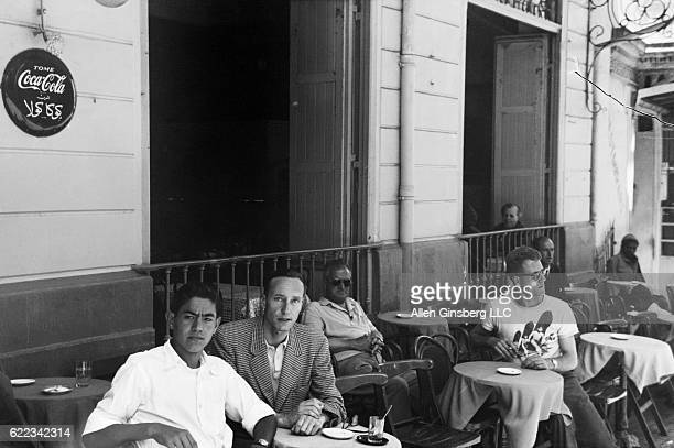 Writer William S Burroughs stops at a sidewalk cafe in the Petit Socco during a trip to Tangier
