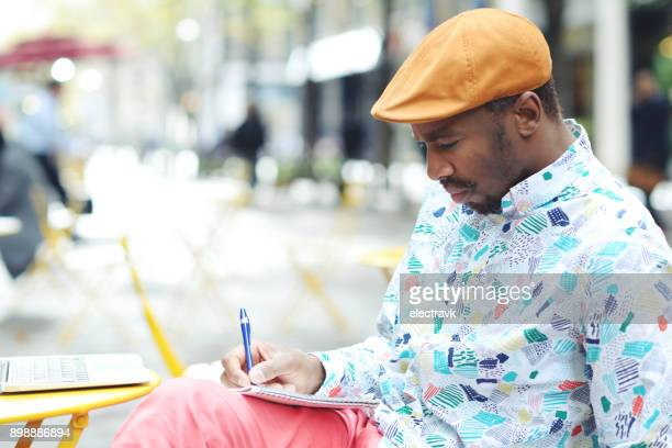 writer working outside - poet stock pictures, royalty-free photos & images