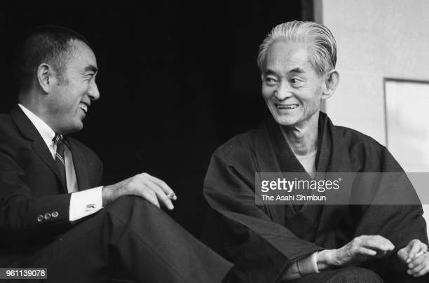 Writer Yasunari Kawabata is congratulated by Yukio Mishima after awarded the Nobel Prize in Literature at his home on October 18 2000 in Kamakura...