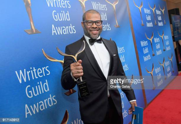 Writer/actor/director Jordan Peele poses with 'Original Screenplay' award for 'Get Out' during the 2018 Writers Guild Awards LA Ceremony at The...