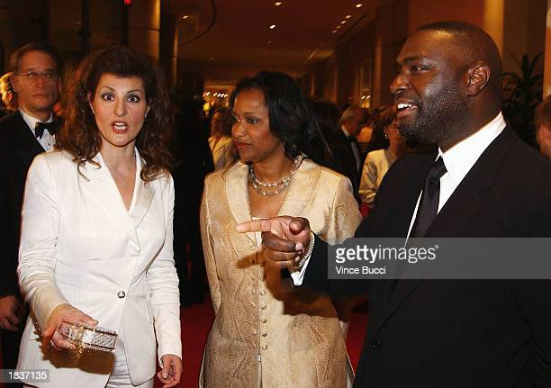 Writer/actress Nia Vardalos talks with writer Antoine Fisher and his wife LaNette attend the 55th Annual Writers Guild Awards at the Beverly Hilton...
