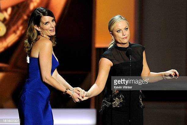 Writer/actresses Tina Fey and Amy Poehler speak onstage during the 65th Annual Primetime Emmy Awards held at Nokia Theatre LA Live on September 22...