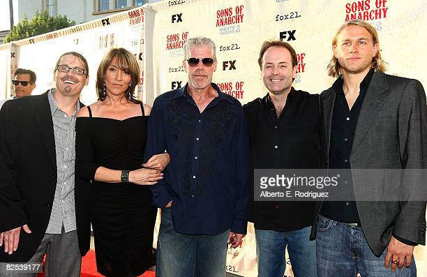 Writer/creator Kurt Sutter actress Katey Sagal actor Ron Perlman FX president John Landgraf and actor Charlie Hunnam arrive at the series premiere...