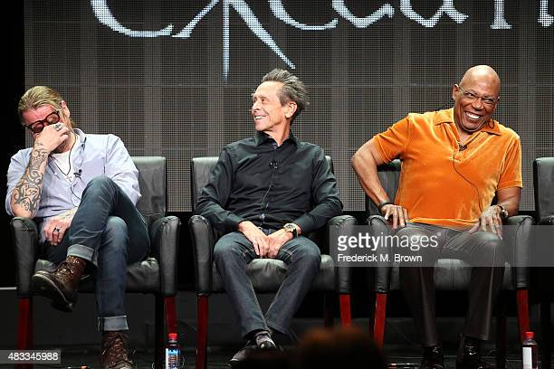 Writer/creator Kurt Sutter executive producer Brian Grazer and producer/director Paris Barclay speak onstage during 'The Bastard Executioner' panel...