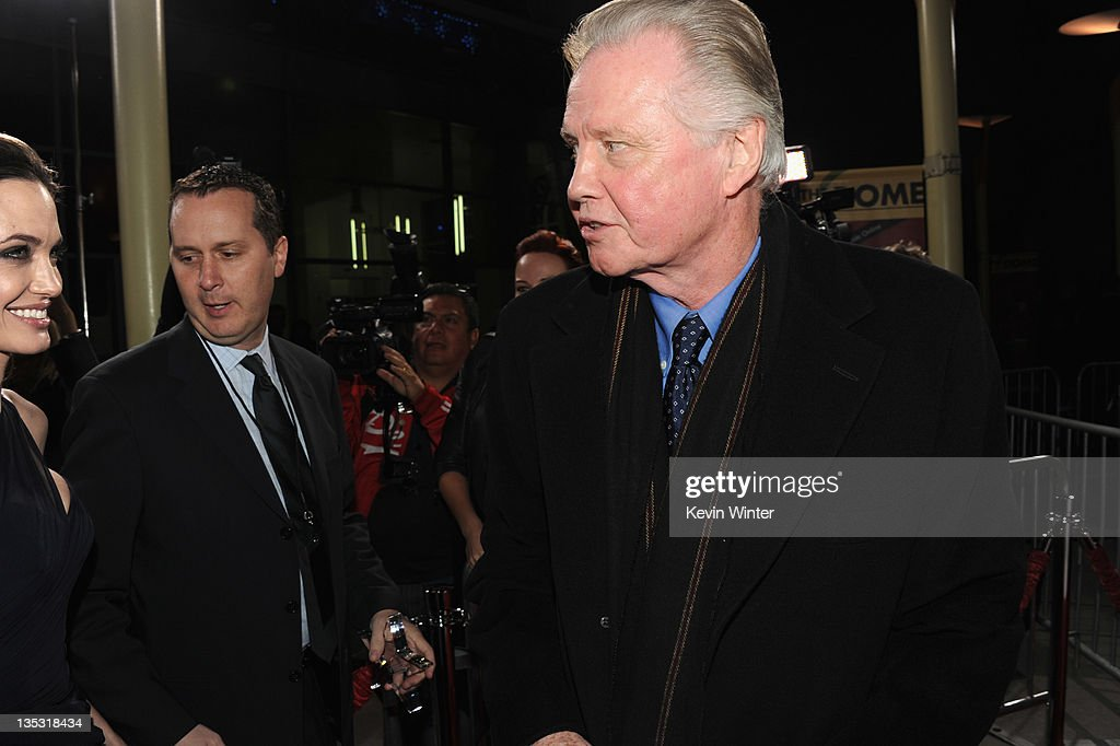 Writer/director Angelina Jolie (L) and actorJon Voight arrive at the premiere of FilmDistrict's 'In the Land of Blood and Honey' held at ArcLight Cinemas on December 8, 2011 in Hollywood, California.