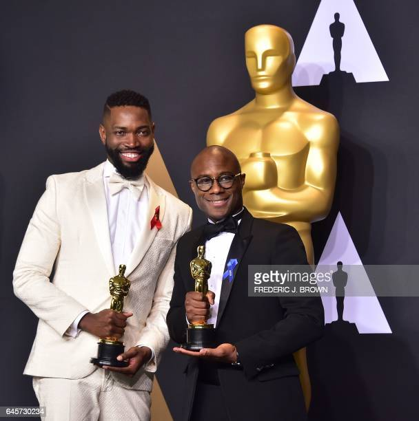 Writer/director Barry Jenkins and writer Tarell Alvin McCraney pose in the press room with the Best Adapted Screenplay award for 'Moonlight' during...