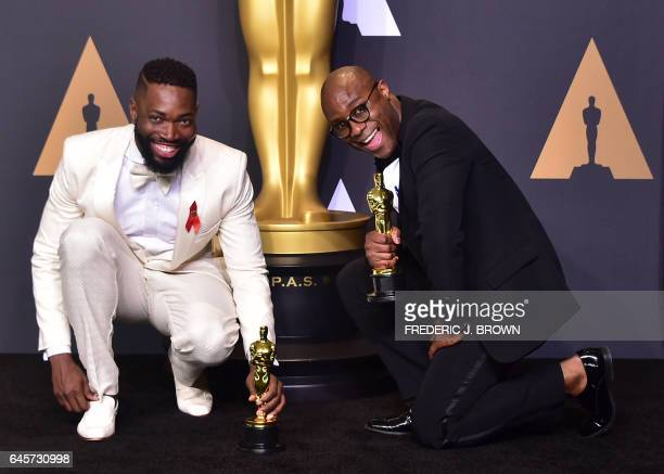 TOPSHOT Writer/director Barry Jenkins and writer Tarell Alvin McCraney pose in the press room with the Best Adapted Screenplay award for 'Moonlight'...