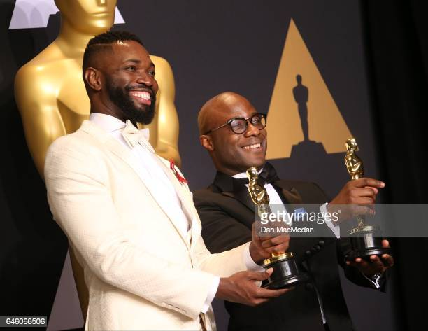 Writer/director Barry Jenkins and writer Tarell Alvin McCraney pose in the press room with the Best Adapted Screenplay award for 'Moonlight' at the...