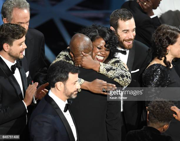 Writer/director Barry Jenkins celebrates winning Best Picture for 'Moonlight' with editors Joi McMillon and Nat Sanders onstage during the 89th...