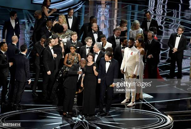 Writer/director Barry Jenkins, producers Adele Romanski and Jeremy Kleiner and cast/crew members accept Best Picture for 'Moonlight' onstage during...