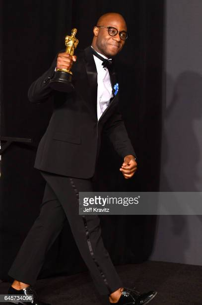 Writer/director Barry Jenkins winner of the Best Adapted Screenplay for 'Moonlight' poses in the press room during the 89th Annual Academy Awards at...