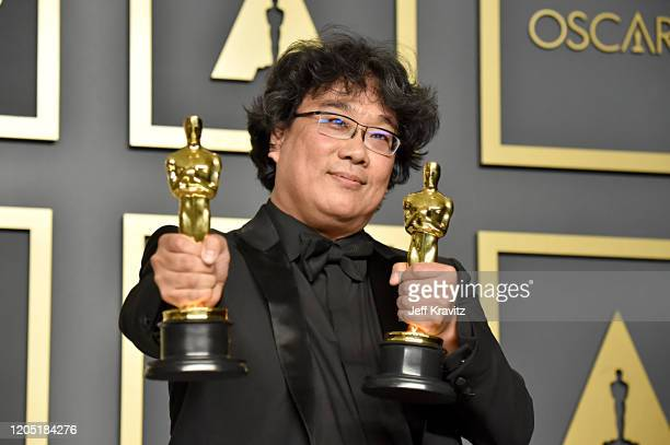 Writerdirector Bong Joonho winner of the Best Picture Director Original Screenplay and International Feature Film awards for Parasite poses in the...