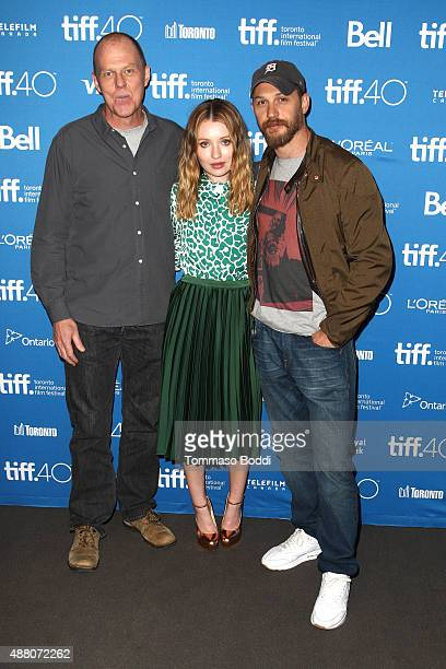 Writer/director Brian Helgeland actress Emily Browning and actor Tom Hardy pose during the Legend press conference at the 2015 Toronto International...