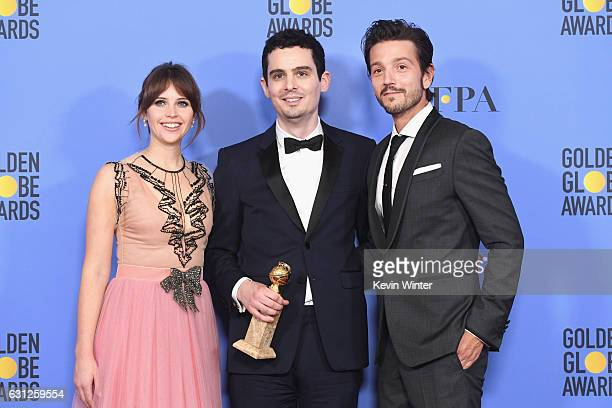 Writer/director Damien Chazelle winner of Best Screenplay for 'La La Land' poses in the press room with actors Felicity Jones and Diego Luna during...