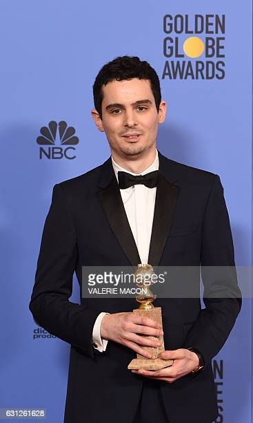 """Writer/director Damien Chazelle, winner of Best Screenplay for """"La La Land"""" poses in the press room during the 74th Annual Golden Globe Awards at The..."""