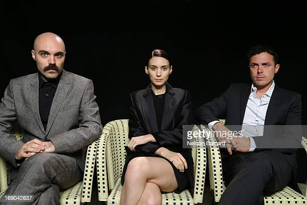 Writer/director David Lowery and actors Rooney Mara and Casey Affleck attend the Variety Studio on May 19 2013 in Cannes France
