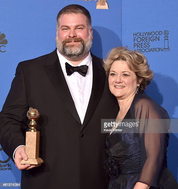 Writer/director Dean DeBlois and producer Bonnie Arnold winners of Best Animated Feature Film for 'How to Train Your Dragon 2' pose in the press room...