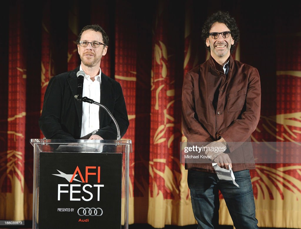 Writer/director Ethan Coen (L) and writer/director Joel Coen introduce the AFI FEST 2013 presented by Audi closing night gala screening of 'Inside Llewyn Davis' at TCL Chinese Theatre on November 14, 2013 in Hollywood, California.