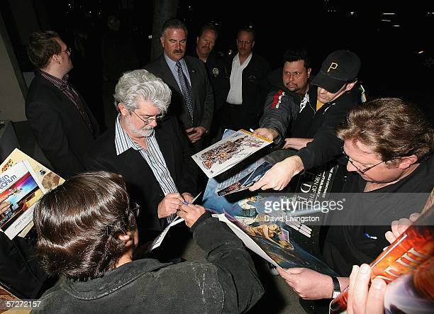Writer/director George Lucas signs autographs as he leaves the 101 Greatest Screenplays gala reception at the Writers Guild Theater on April 6, 2006...