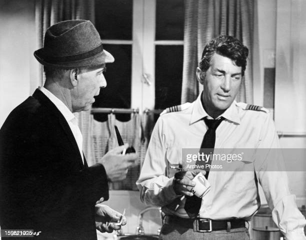 Writerdirector George Seaton discussing movie scene with Dean Martin on the set of the film 'Airport' 1970